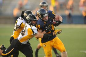 KSU's Kyle Patton fights for extra yards after a catch