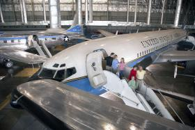 Visitors check out a former Air Force One plane in the Presidential Gallery at the National Museum of the United States Air Force.