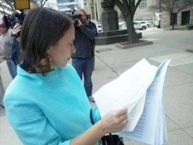 Amy Murray reviews petition signatures before submitting the forms to the city.