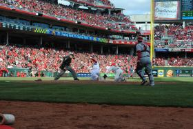 Center fielder Shin-Soo Choo scores the Reds first run on Opening Day.