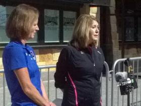 Iris Simpson-Bush (right) and Tammy Wise with the Flying Pig Marathon discuss safety precautions for the upcoming race.