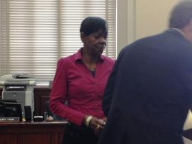Melowese Richardson, with her attorney, in a Hamilton County Court.