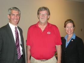 Ohio Representative Peter Stautberg, WVXU's Howard Wilkinson and Ohio Representative Denise Driehaus