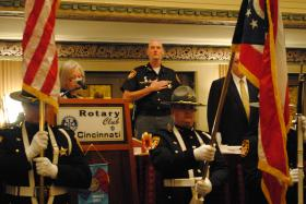 The colors are presented just before Sheriff Jim Neil's speech at the Cincinnati Rotary Club.