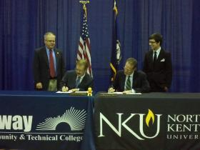 Gateway President/CEO Ed Hughes and NKU President Geoffrey Mearns sign the partnership documents.