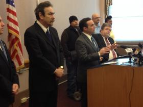 Mayor John Cranley surrounded by city union leaders at a city hall press conference