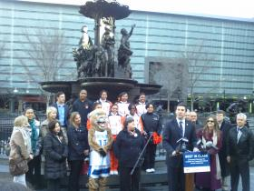 Cheerleaders, mascots, school officials and the Cincinnati Convention & Visitors Bureau join council member P.G. Sittenfeld on Fountain Square to announce the convention.