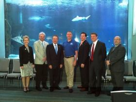 Sen. Katie Stine, City of Newport Commissioner John Hayden, Rep. Dennis Keene, Newport Aquarium Vice President and Executive Director Eric Rose,  offices of Kentucky Gov. Steve Beshear, Newport Vice Mayor Tom Guidugli, Campbell County Judge Executive Steve Pendery, and Todd Cassidy with The Kentucky Department of Travel and Tourism.