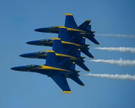The Blue Angels flying in formation.