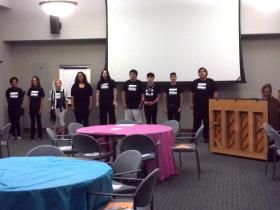Members of the DiverseCity Youth Chorus rehearse before performing at the community forum Tuesday.