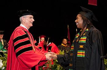 President Williams congratulates a member of the Class of 2012.