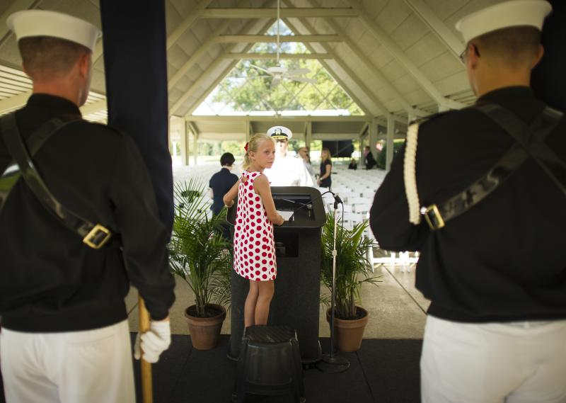 Piper Van Wagenen, one of Neil Armstrong's 10 grandchildren, is seen during preparation of a memorial service celebrating the life of Neil Armstrong, Friday, Aug. 31, 2012, at the Camargo Club in Cincinnati.