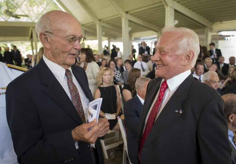 Apollo 11 Astronauts Michael Collins, left, and Buzz Aldrin talk at a private memorial service celebrating the life of Neil Armstrong, Aug. 31, 2012, at the Camargo Club in Cincinnati.