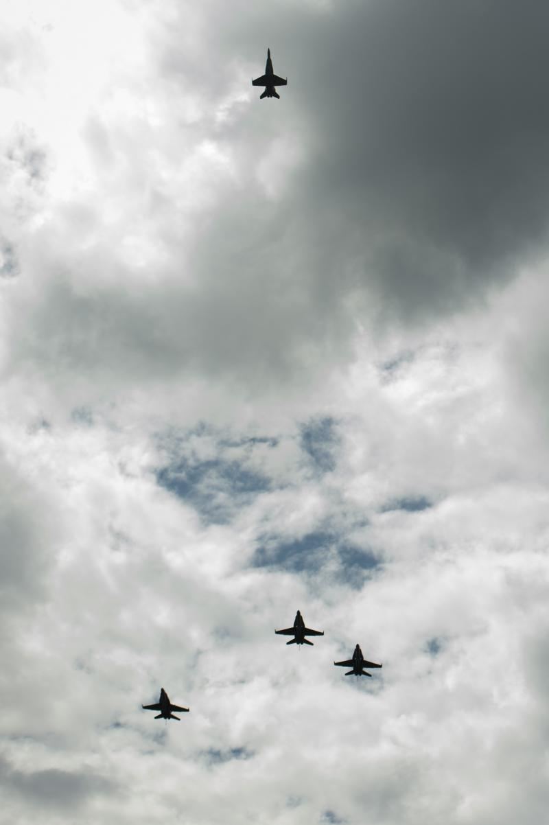 "U.S. Navy F/A-18 jets from Strike Fighter Squadron (VFA) 106 and Strike Fighter Squadron (VFA) 34, from Naval Air Station Oceana (Va.) fly in a ""Missing Man"" formation over the Camargo Club following a memorial service celebrating Neil Armstrong's life."