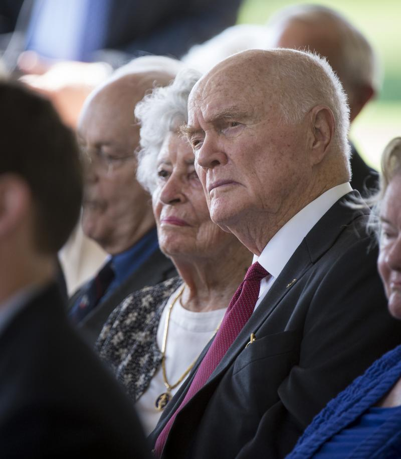Sen. John Glenn and his wife Annie listen during a memorial service celebrating the life of Neil Armstrong, Friday, Aug. 31, 2012, at the Camargo Club in Cincinnati.