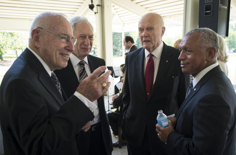 Apollo 13 Astronaut Jim Lovell, left, former NASA Administrator Dan Goldin, Sen. John Glenn, third from left, and NASA Administrator Charles Bolden, right, talk at a private memorial service.