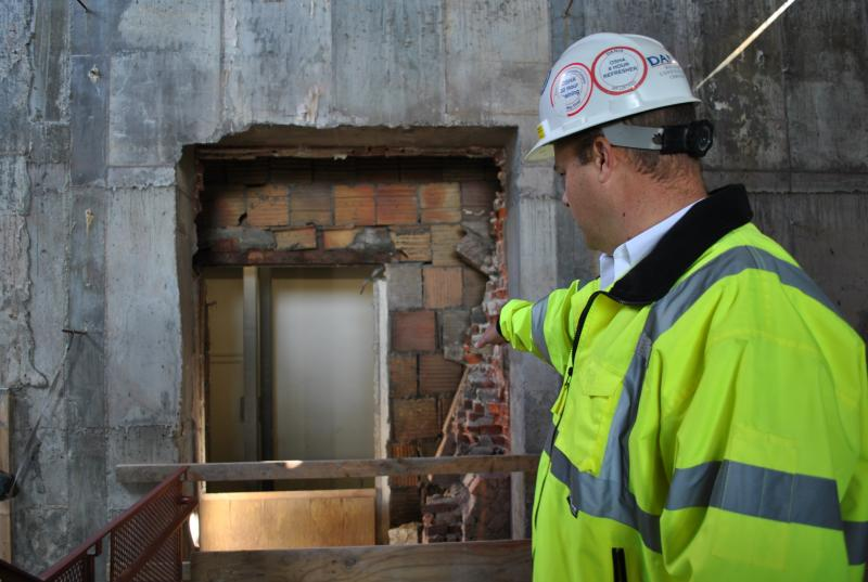 Project Manager Mike McTall shows how an old entrance is being reopened onto the main Art Museum.