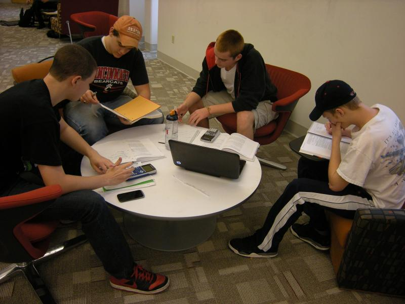 A group of second year electrical engineering students collaborate on a problem.