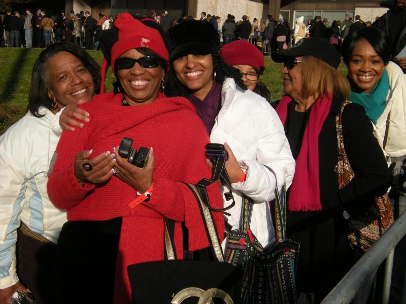 Kim Wright (in red) was the first in line to see the President, showing up at 6:30am