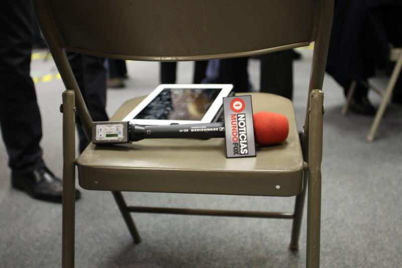A reporter from Mundofox sets down his tools of the trait for a minute while covering the events at the Board of Elections.