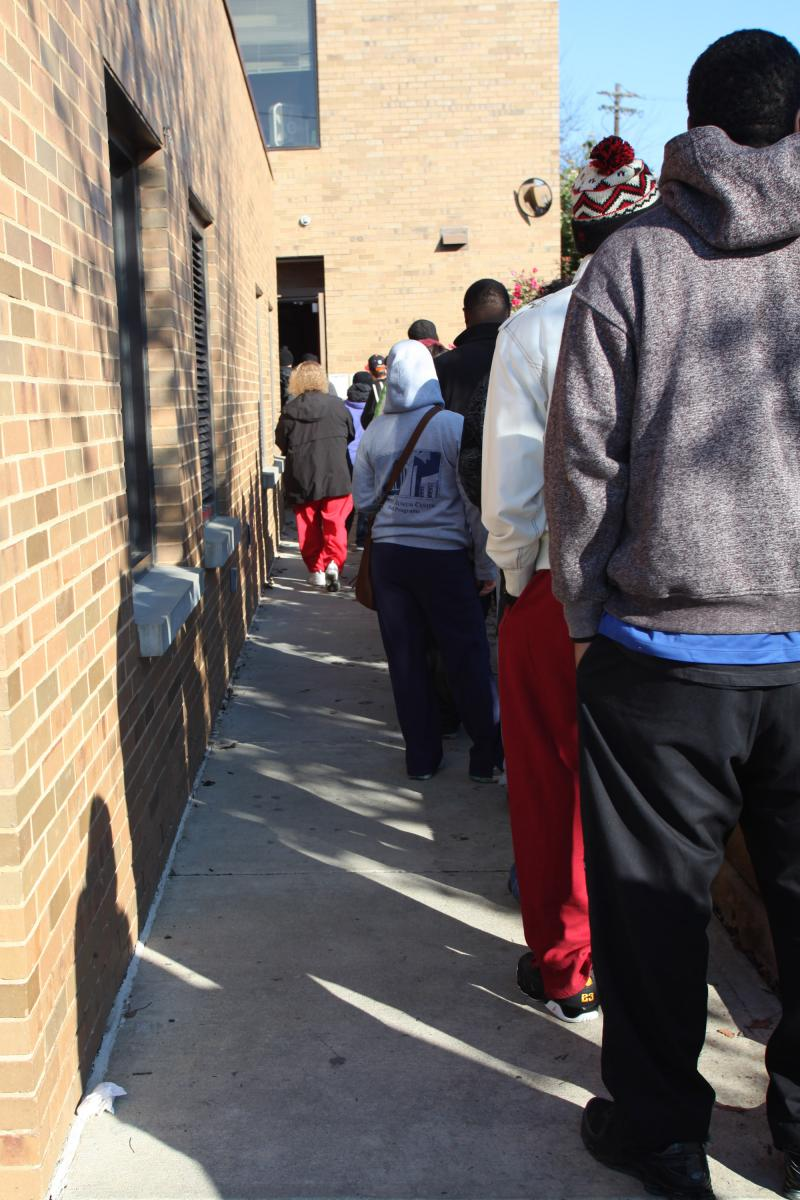 Two different precincts voting at the Pleasant Ridge Community Center; however, one line is much longer than the other.