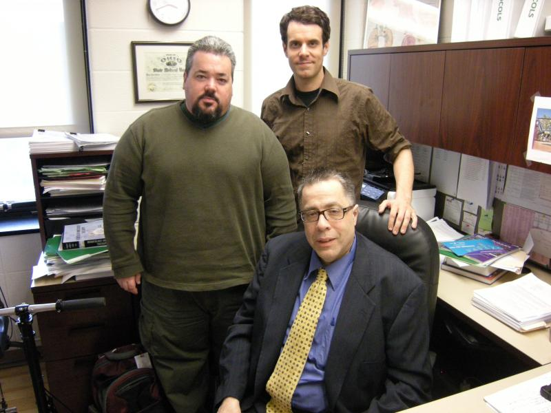 Researchers: 2.(seated) John C. Morris, MD (standing) left-Dr. Jason Steel, right-Dr. Brian Morrison, post-doctoral fellow