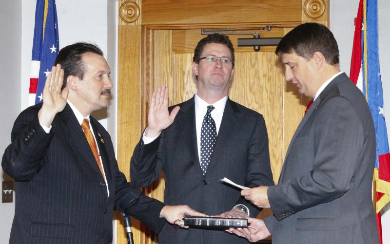 Commissioners Portune and Hartmann take the oath of office from Board President Chris Monzel.