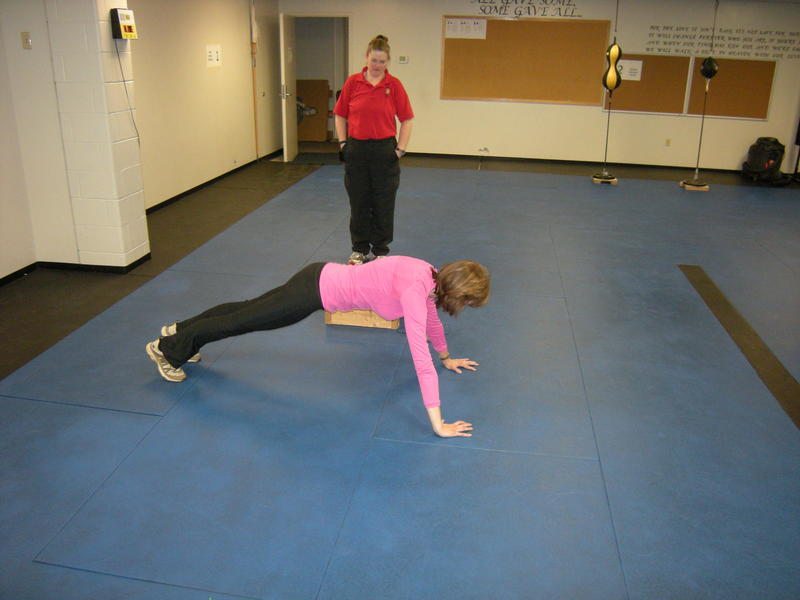 WVXU reporter Ann Thompson struggles to do push ups in the police fitness test