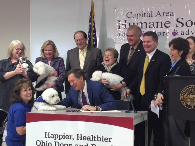 Gov. John Kasich signs a puppy mill bill into law.