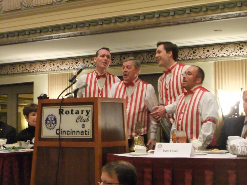A barbershop quartet serades a pair of Rotarians at the start of the Valentine's day meeting.