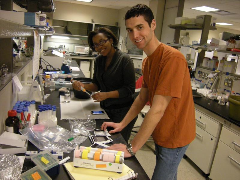 from left, Tafadzwa Chihaga and Joe Nowatzke work in a Miami University wet lab.