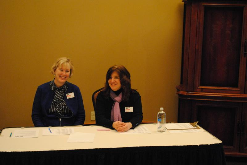 Robin Gehl (left) and Maryanne Zeleznik (right) at the check-in table