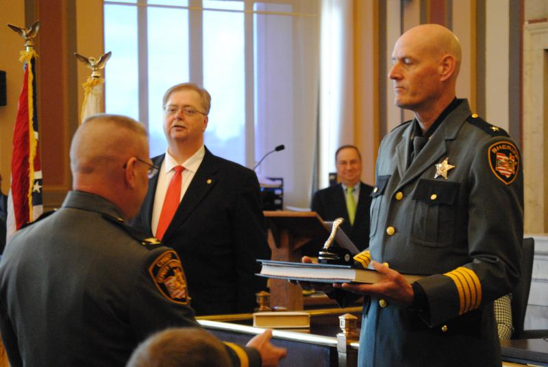 Chief Deputy Mark Schoonover presents the Sheriff's Seal and Book of Records.