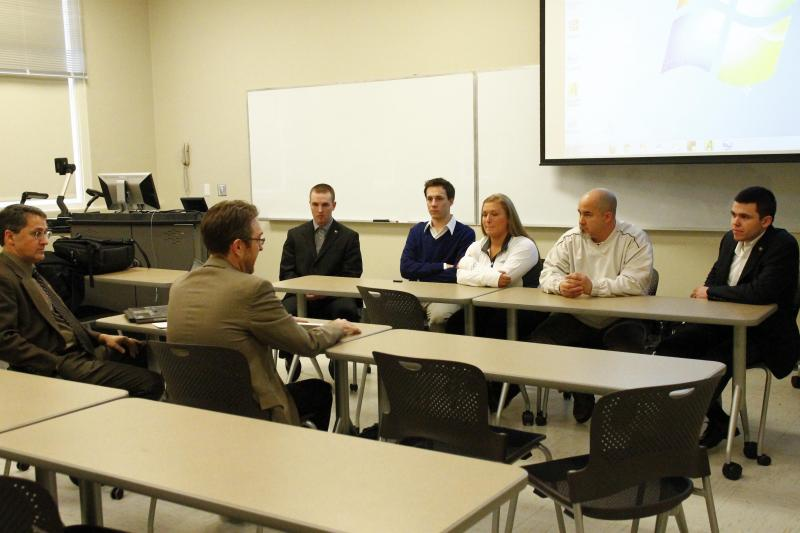 A team of UC students update Drs. Richard Harknett and Mark Stockman on their project.