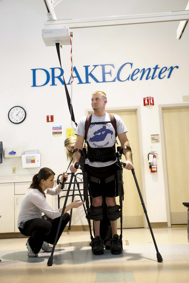 Kevin Moeller walks with the help of the Exoskeleton.