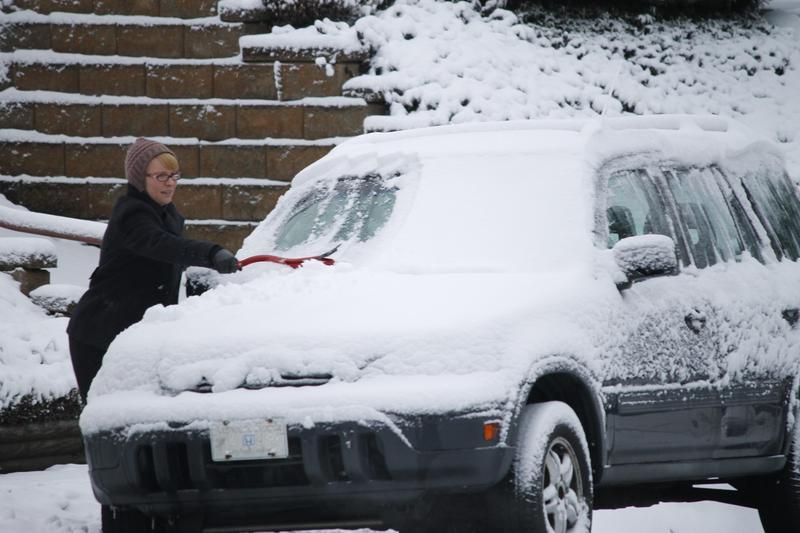 woman scraping car