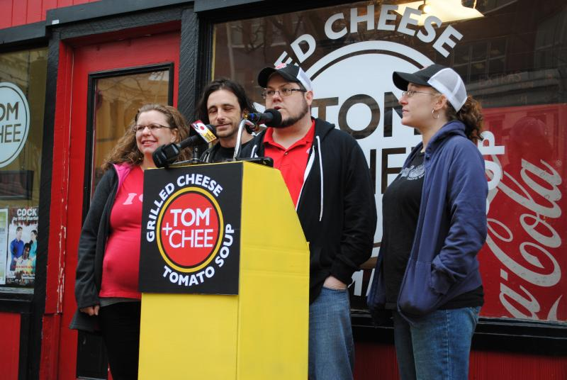 Tom + Chee owners Corey Ward and Trew Quackenbush with their wives in front of the Court St. location.