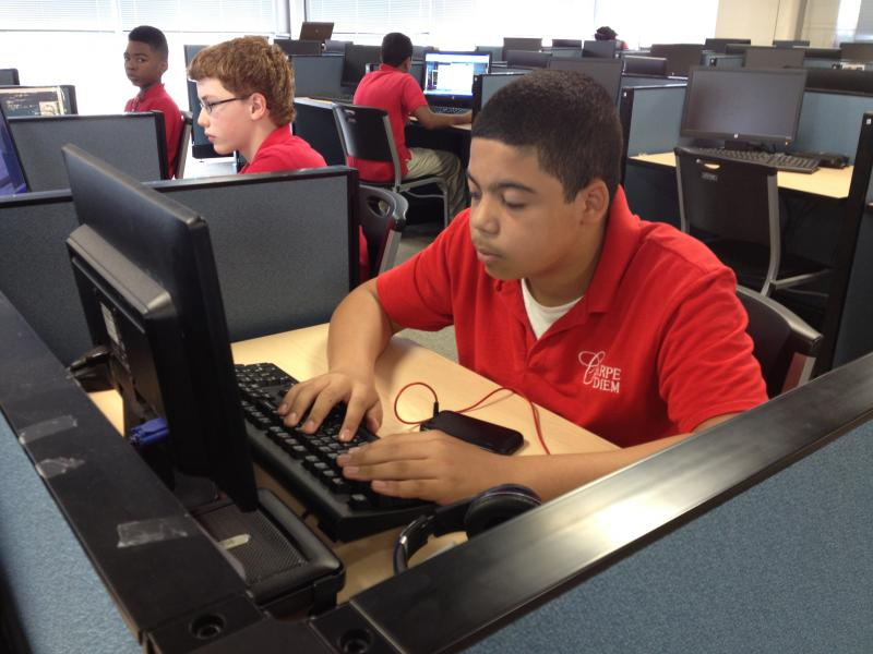 The other half of the day students spend in individualized computer learning. 8th Grader Jaylen Byard.