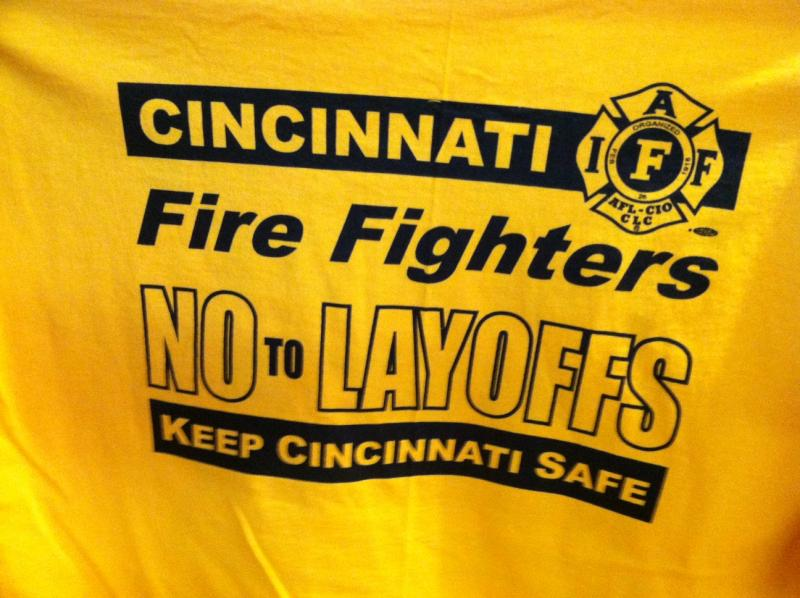 T-shirts worn by some Cincinnati firefighters during Thursday night budget hearing