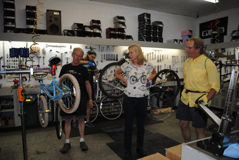 Chris Lonsberry, Cheryl Sussel and Jim Craven in the shop at Bishop's Bicyles in Milford