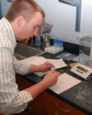 Matt Meriweather studies bacteria in bed bugs in Baucom's lab.