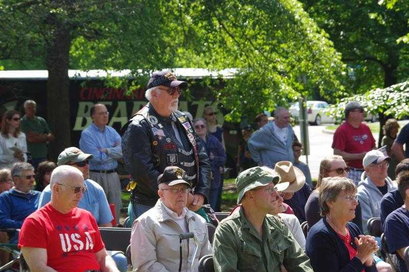 A Vietnam veteran stands as the service anthem from his branch of the military is played.