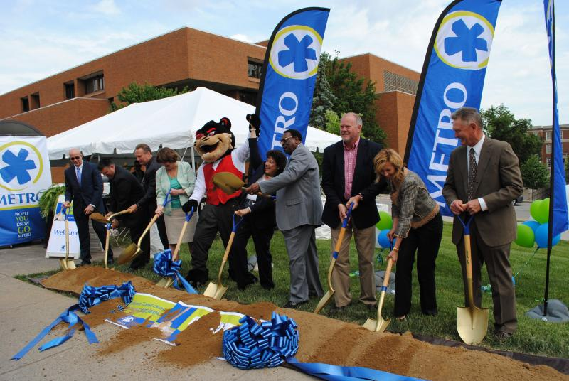 Metro, business and city leaders join the UC Bearcat in breaking ground on the Uptown Transit District plan.