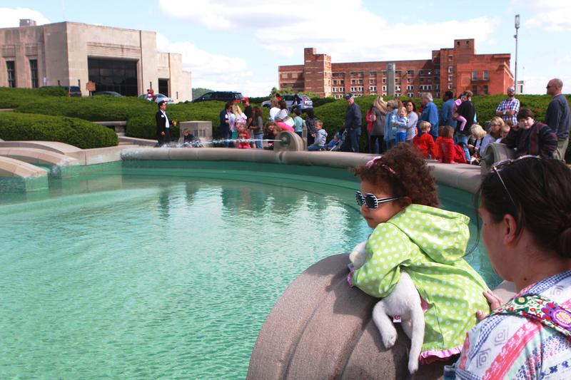 Mimi Bowman, 2 ½, and mother Sarah of Fairfield watch as the Museum Center Fountain is turned on for the summer.