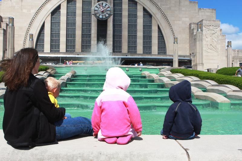 Amy Sellers and her children Monica, 4, and 2 ½-year-old twins Will and Ben, watch as the Museum Center fountain springs to life.