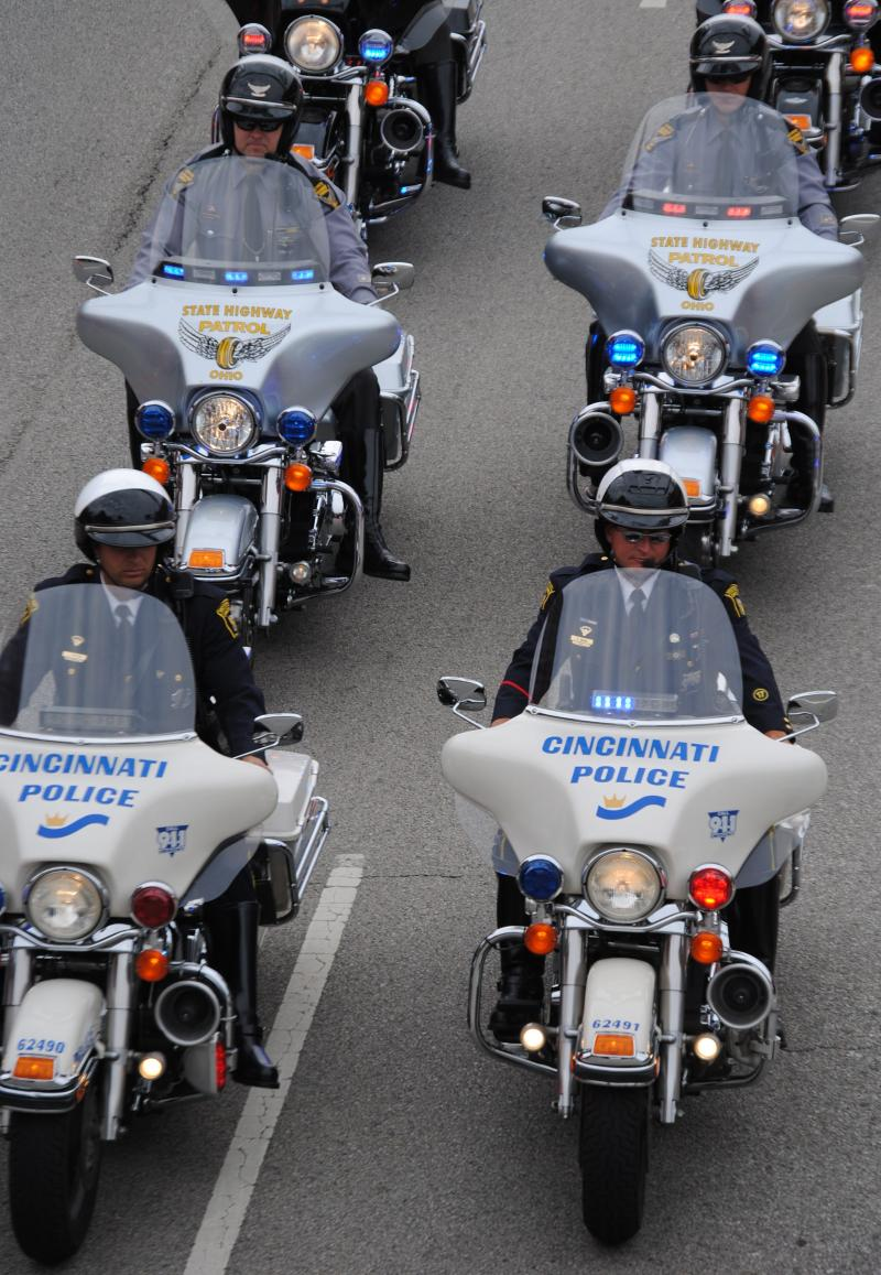 Motorcycle officers led the parade up Central Parkway.