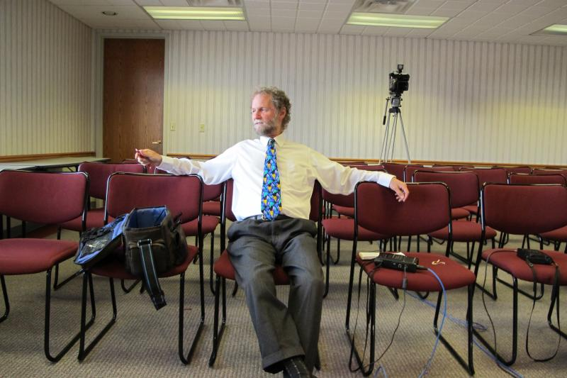 Bill Relaxing before a news conference last year