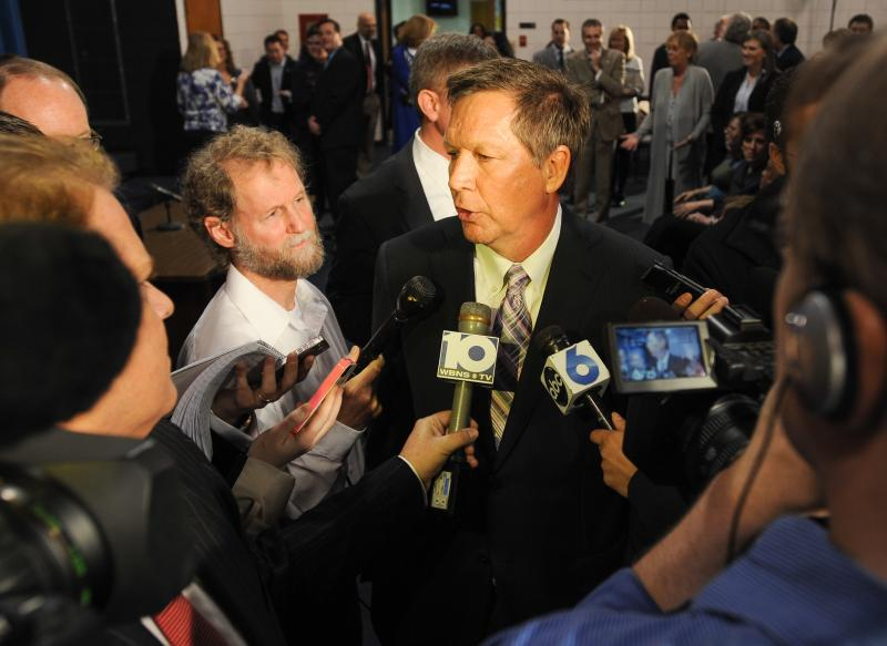 Bill at a news conference with Governor John Kasich