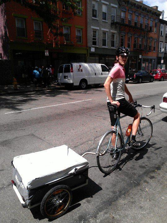 Sam Klontz from Park + Vine with bike trailer that was a gift from Ohio Citizen Action