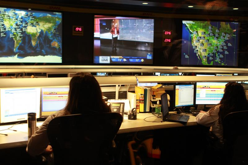 Employees monitor weather and news in DHL's network control room.